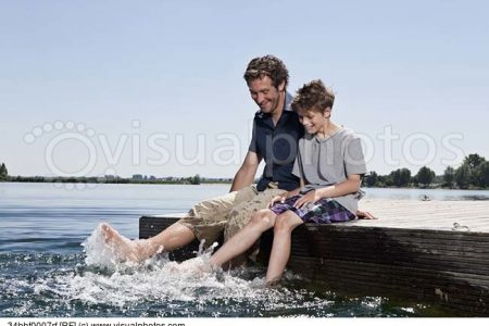 father-and-son-relaxing-together-on-dock